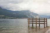 picture of dock a lake  - Beautiful view of boat dock on Como lake in Italy - JPG