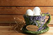 picture of bird egg  - Bird colorful eggs in decorative mug on light background - JPG
