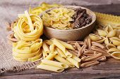 picture of pasta  - Different types of pasta on rustic wooden table - JPG