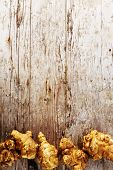 stock photo of jerusalem artichokes  - Fresh organic topinambur on wooden background - JPG