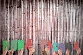 picture of pasqua  - Hands holding up bona pasqua against wooden planks - JPG