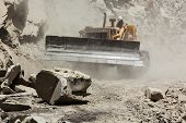 foto of landslide  - Bulldozer cleaning landslide from road in Himalayas - JPG