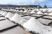 foto of salt mine  - salt piles in the saline of Janubio in Lanzarote - JPG