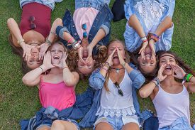 foto of shout  - group of kids shouting or singing with cupped hands - JPG