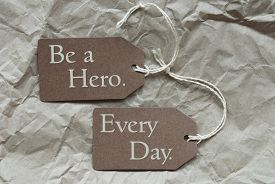 picture of incredible  - Two Brown Labels Or Tags With White Ribbon On Crumpled Paper Background With English Life Quote Be A Hero Every Day Vintage Or Retro Style - JPG