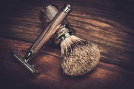 picture of barber razor  - Safety razor and shaving brush on a wooden background  - JPG
