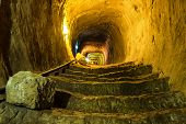 image of dungeon  - Mysterious dungeon- tunnel with walls made of stone ** Note: Shallow depth of field - JPG