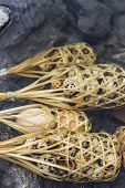 stock photo of quail  - Quail eggs in round bamboo basket boil on hot spring - JPG