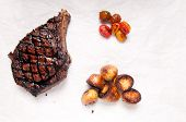 stock photo of rib eye steak  - barbequed beef rib steak grilled to perfection with salad and potato - JPG