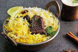 foto of raita  - Beef biryani in a kadai with basmati ruce and raita - JPG