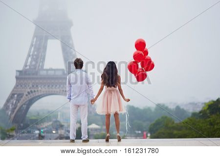 poster of Romantic Couple With Red Balloons Together In Paris