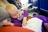 stock photo of teats  - toddler girl sleeping on plane - JPG