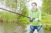 picture of fisherwomen  - woman fishing in pond - JPG