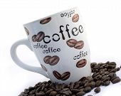 stock photo of coffee-cup  - isolated coffee cup and beans - JPG
