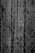 chain link fence see old wooden background