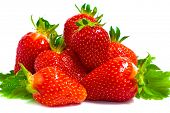 fresh strawberry fruits with green leaves isolated on white background