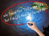 Постер, плакат: Woman Hand Writing We Travel Not To Escape Life But For Life Not To Escape Us With Marker Over Tra