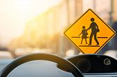 School Zone Warning Sign And Inside Car View ,steering Wheel On Blur Traffic Road With Colorful Boke poster