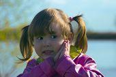 Beautiful Little Girl Outdoors poster