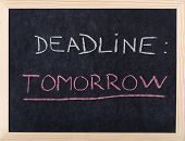 tomorrow deadline written on blackboard