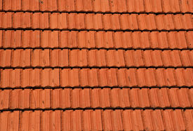stock photo of red roof  - red roof tiles useful as a background - JPG