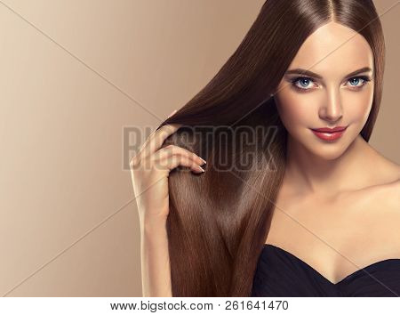 poster of Beautiful Model Girl With Shiny Brown And Straight Long  Hair . Keratin  Straightening . Treatment,
