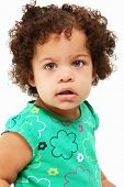 Adorable 1 year old hispanic african american girl over white background.