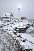 Winter view of the Portland Head Light in Maine during snow storm.