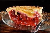 pic of cherry pie  - A rich fresh slice of cherry pie with a black background - JPG