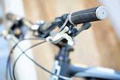 Outdoor shot of a sport bicycle control. Closeup.