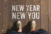 Aerail View Of New Year New You Word On Wooden Plank Floor With People Foot Wear Canvas Shoe Standin poster