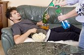 Man With Beer And Chips Watching Tv At Home. Wife And Husband Relationship poster