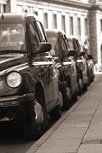 picture of hackney  - London taxis on a taxi rank in black and white - JPG