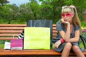 shopping blond woman in pink glass with shoppingbag