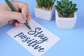 Womans Hand Writing stay Positive On Paper Sheet poster