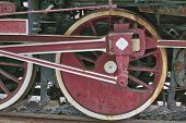 Rusty Flywheel Of A Steam Locomotive, The Flywheel Disperses The Train With The Energy Of Compressed poster