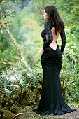 beauty Brunette woman in Abkhazia forest in summer time