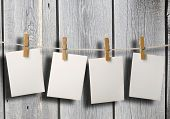 white photopaper on old wood fence background texture