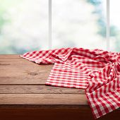 Red Checkered Tablecloth On Wooden Table On Empty Wooden Table Near The Window In Kitchen. Napkin Cl poster
