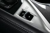 Track Control Buttons Near Automatic Gear Stick Of A Modern Car In Black Leather Interior With Stitc poster