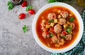 Hot Stew Tomato Soup With Meatballs And Vegetables Closeup In A Bowl On The Table. Albondigas Soup,  poster