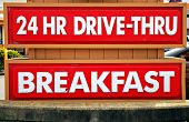 24 Hour Drive-Thru and Breakfast sign at a fast food restaurant