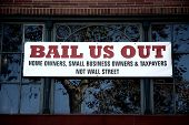 Bail Us Out sign on a building, November 2008