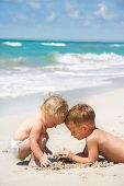 foto of summer fun  - two kids playing on beach - JPG