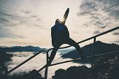 Man With Raised Hand On Top Of A Mountain, Concept Of Inspiration, Enthusiasm And Aspiration poster