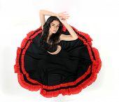 studio portrait of young attractive woman dancing flamenco