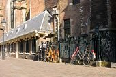 A street scene in perspective, with parked bicycles adjacent to a church in Haarlem, the Netherlands