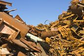 Heaps of different kinds of metal scrap in a scrap yard