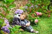 Unhappy And Miserable. Little Boy In Deep Sorrow. Little Boy With Sad Look Hide In Garden. Little Ch poster