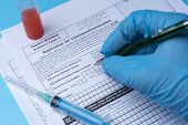 Laboratory Technician Writes The Test Results In The Form. poster